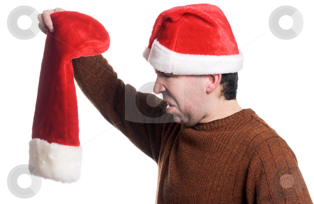 Empty Christmas Stocking stock photo, Profile view of a man wearing a Santa hat looking disgusted that his stocking is empty, isolated against a white background by Richard Nelson