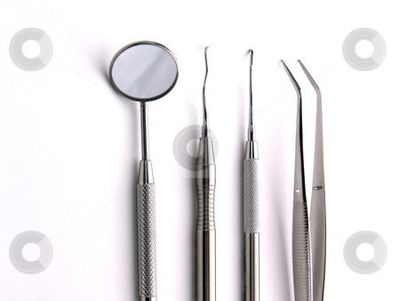 Dental Instruments stock photo, Close-up Dental Instruments on white background by Adam Radosavljevic