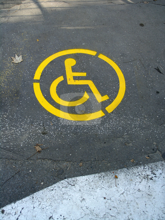 Wheelchair Symbol stock photo, Wheelchair Symbol on street by Adam Radosavljevic