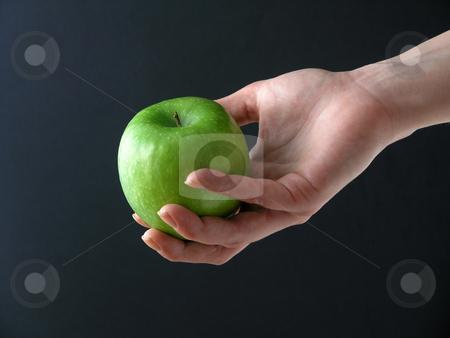 Apple in hand stock photo, Apple in hand on black background by Adam Radosavljevic