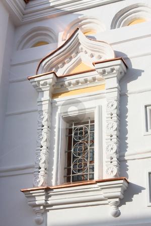 Carved stone window stock photo, Beautiful carved window of Orthodox church by Olga Lipatova
