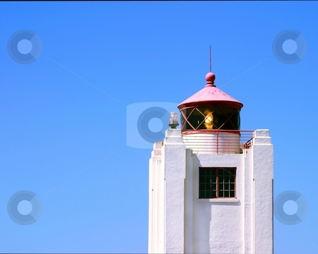 Light house stock photo, Light house with a blue sky in the background by Henrik Lehnerer
