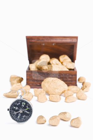 Guidance to wealth concept stock photo, Guidance to wealth concept using compass and golden nuggets with treasure chest on background by Rudyanto Wijaya