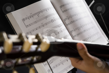 People playing guitar with musical chords stock photo, People playing guitar with musical chords in dark by Rudyanto Wijaya
