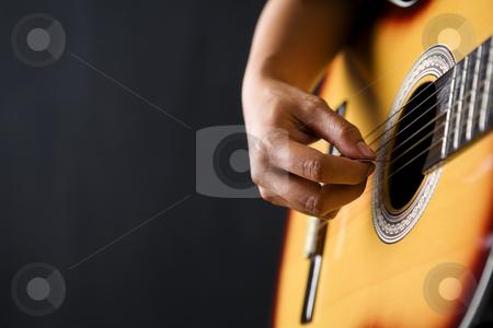 People playing classic guitar stock photo, Close up people playing classic guitar on dark room by Rudyanto Wijaya