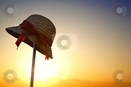 Hat silhouette against summer sunlight stock photo, Hat silhouette against summer sunlight in the morning by Rudyanto Wijaya