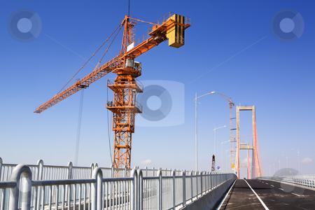 Crane in bridge area stock photo, Crane in bridge area in the morning by Rudyanto Wijaya