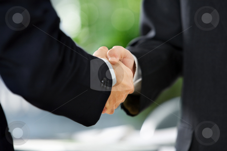 Handshake between two businessmen stock photo, Close up image of handshake between two businessmen. East Asian skin tone by Rudyanto Wijaya