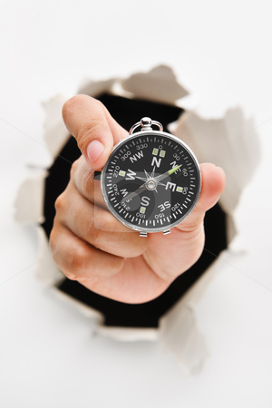Hand breakthrough wall holding compass stock photo, Hand breakthrough wall holding compass - one of the breakthrough series by Rudyanto Wijaya
