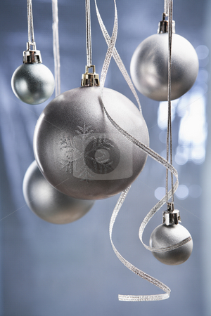 Christmas ornaments stock photo, Group of silver Christmas ornament with bluish background by Rudyanto Wijaya