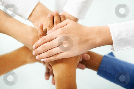 Diverse people hand in unity stock photo, Multi colored hand of people hand in unity to express togetherness in community by Rudyanto Wijaya