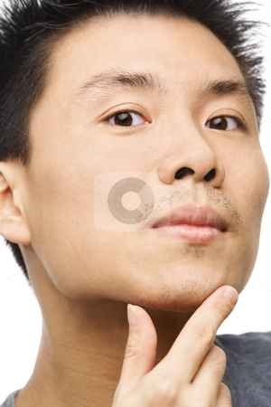Asian man looking his unshaved chin stock photo, Close up portrait of Asian man looking his unshaved chin by Rudyanto Wijaya