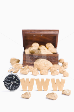 Guidance in WWW to bring wealth concept stock photo, Guidance in WWW to bring wealth concept using compass, www characters block and treasure chest and golden nuggets by Rudyanto Wijaya