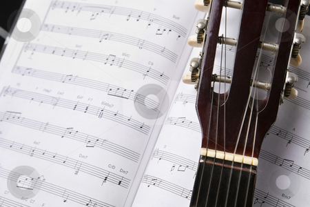 Classic guitar and music chords stock photo, Close up of a classic guitar and musical chords book by Rudyanto Wijaya