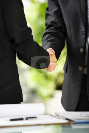 Two businessman handshake stock photo, Close up vertical portrait of two businessman handshaking, East Asian skintone by Rudyanto Wijaya