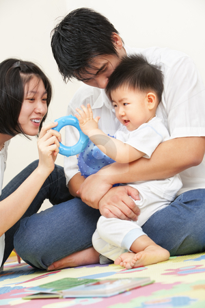 Asian young family spending time together stock photo, Asian young family spending time together, playing with their little son by Rudyanto Wijaya