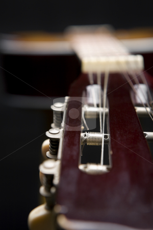 Classic guitar stock photo, CLose up of a classic guitar in dark by Rudyanto Wijaya