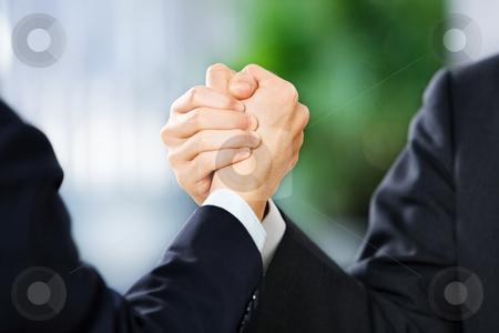 Two businessman grasp each other hand stock photo, Two businessman grasp each other hand, East Asian skin tone. by Rudyanto Wijaya