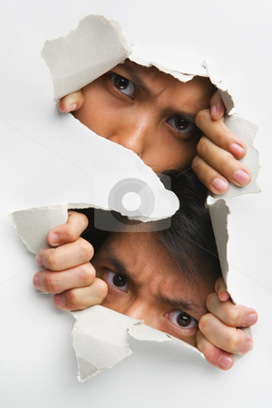 Two people peeking from hole in wall stock photo, Two people peeking from hole in wall showing their eyes only by Rudyanto Wijaya