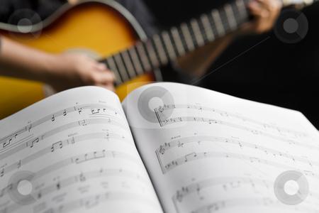People playing guitar with musical chords stock photo, People playing guitar with musical chords in dark room by Rudyanto Wijaya
