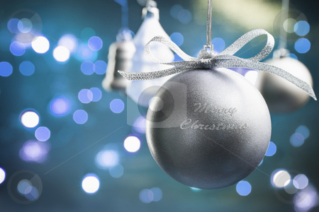 Christmas ornaments stock photo, Round silver Christmas ornament with bluish background filled with blur light by Rudyanto Wijaya