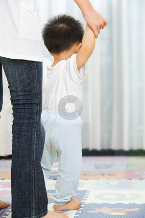 Mother guide her son to walk stock photo, Mother guide her little son to walk in bedroom by Rudyanto Wijaya