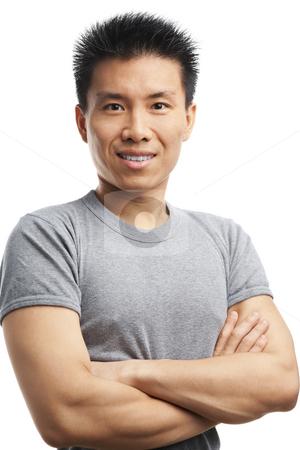 Fitness Asian young man stock photo, Studio shot of a fitness Asian young man by Rudyanto Wijaya