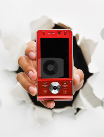 Breakthrough in telecommunication technology stock photo, Hand holding new red cell phone mean breakthrough in telecommunication technology - one of the breakthrough series by Rudyanto Wijaya