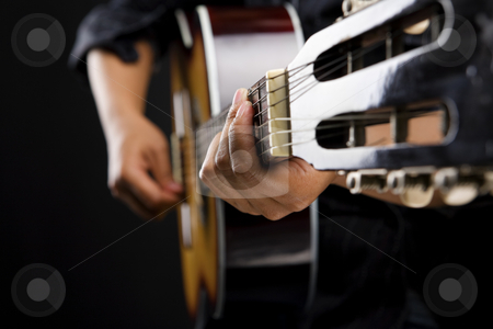 People playing classic guitar stock photo, Close up people playing classic guitar on dark room by Rudyanto Wijaya