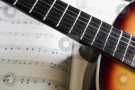 Classic guitar and music chords stock photo, Classic guitar on top music chords books by Rudyanto Wijaya