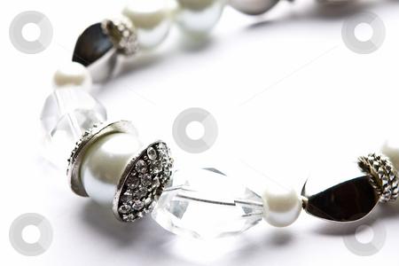 Costume Juwelery stock photo, Silver designer costume jewelery in macro on white background by Adriaan Van den Berg