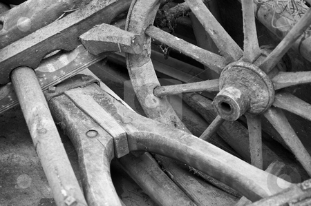 Wagon wheel and yoke stock photo, Old wooden wagon wheel and yoke in black and white by Thomas Gavagan