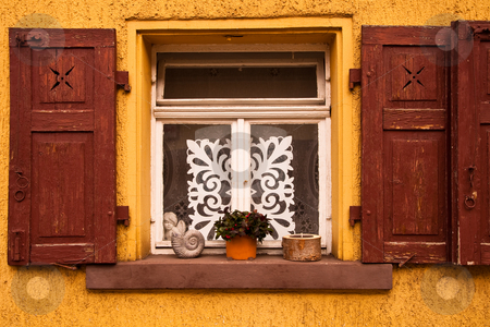 Picturesque window and shutters stock photo, Picturesque window and shutters on a 17th century German house by Thomas Gavagan