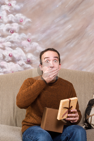 Shocked Xmas stock photo, A young man is happy for receiving his xmas present by Richard Nelson