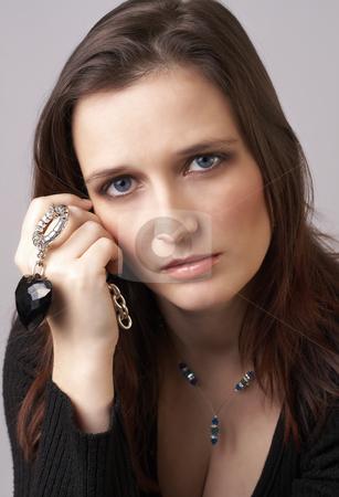 Portrait of beautiful brunette woman stock photo, Portrait of a beautiful mature brunette woman with dramatic make-up in soft light by Elena Weber (nee Talberg)