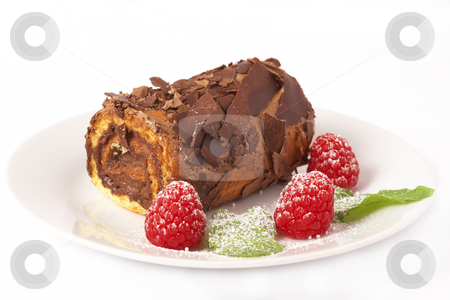 Miniature chocolate swiss roll stock photo, Miniature chocolate swiss roll cake served on a plate with mint leaves and raspberries on white background by Elena Weber (nee Talberg)