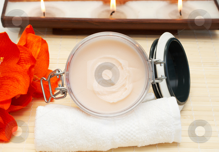 Relaxing spa scene with body products stock photo, Relaxing spa scene with nourishing and exfoliating body scrub, white towel and candles in the background by Elena Weber (nee Talberg)