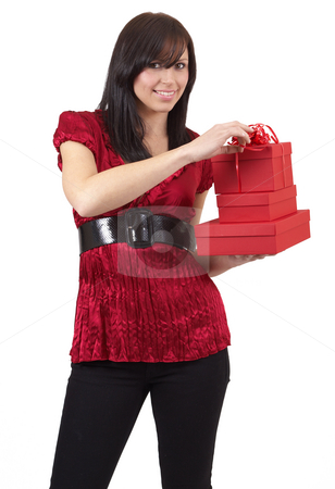 Portrait of beautiful brunette woman stock photo, Portrait of a beautiful young brunette woman holding gift boxes at a celebration. Isolated on white background by Elena Weber (nee Talberg)
