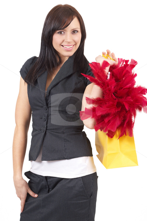 Portrait of beautiful brunette woman stock photo, Portrait of a beautiful young brunette woman holding a shopping bag with red fur in it. Isolated on white background by Elena Weber (nee Talberg)