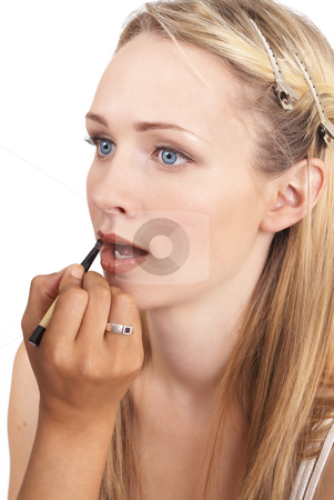 Portrait of beautiful blonde woman stock photo, Portrait of a beautiful blonde woman with light blue eyes and natural make-up being applied by artist isolated on white background by Elena Weber (nee Talberg)