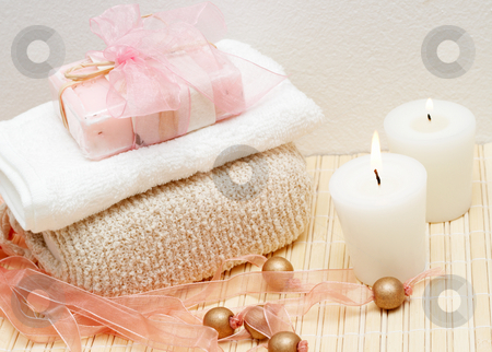 Relaxing spa scene with body products stock photo, Relaxing spa scene with exfoliating body sponge, face towel, handmade soap and candles by Elena Weber (nee Talberg)