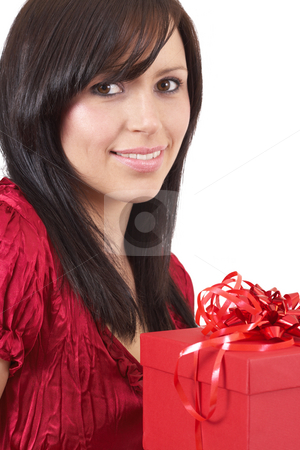 Portrait of beautiful brunette woman stock photo, Portrait of a beautiful young brunette woman holding gift box at a celebration isolated on white background by Elena Weber (nee Talberg)