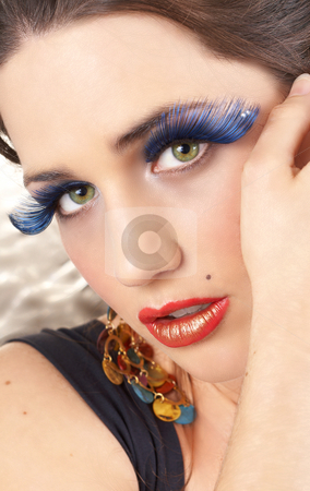 Portrait of beautiful brunette woman stock photo, Portrait of a beautiful young brunette woman with dramatic glamour make-up and fashionable earrings by Elena Weber (nee Talberg)