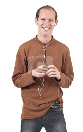 Young caucasian man listening to music stock photo, Young caucasian man wearing trendy clothes listening to music. Isolated on white background by Elena Weber (nee Talberg)