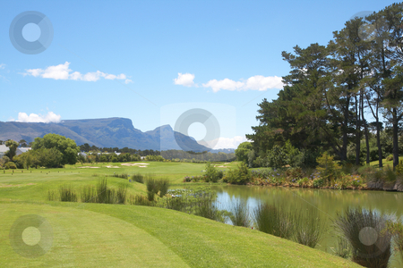 Golf course landscape in the mountains  stock photo, Golf course landscape in the mountains on a beautiful summer day with blue skies by Elena Weber (nee Talberg)