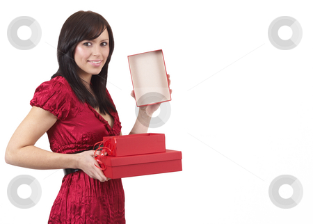 Portrait of beautiful brunette woman stock photo, Portrait of a beautiful young brunette woman opening gift boxes at a celebration. Isolated on white background by Elena Weber (nee Talberg)