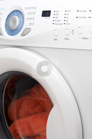 White washing machine stock photo, White washing machine with orange towels inside by Elena Weber (nee Talberg)