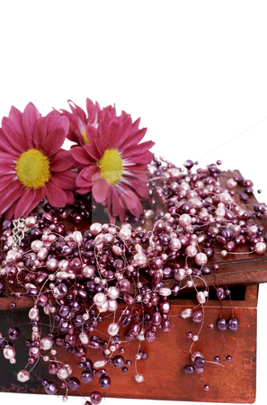 Fake pink pearls with pink flowers stock photo, Fashionable fake pink pearls with bright pink flowers on aged dark wooden box, isolated on white background by Elena Weber (nee Talberg)