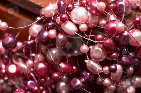 Beautiful fake pink pearl necklace stock photo, Beautiful fake pink pearl necklace on dark wooden box - very shallow depth of field (macro) by Elena Weber (nee Talberg)
