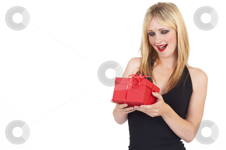 Portrait of beautiful blonde woman stock photo, Portrait of a beautiful blonde woman with light blue eyes and colorful make-up holding a gift box in surprise isolated on white background by Elena Weber (nee Talberg)